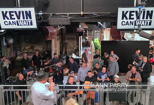 "Bethpage, New York, USA. August 19, 2016. Actor KEVIN JAMES (middle of low railing) the star of the CBS new comedy series ""Kevin Can Wait"" set to premiere mid September 2016, autographs copies of the script cover of the first episode, right after filming is completed. After the pilot was shot,13 episodes were ordered in May. The Sony Pictures Television Inc show is the first series to be shot entirely on Long Island, and is filmed at Gold Coast Studioes. Kevin James, a Long Island native, portrays the title character Kevin Gable, a newly retired police officer who lives with his family in Massapequa. Other cast members, several who also autographed the cover, include: Erinn Hayes as his wife Donna, a school nurse; Taylor Spreitler as their older daughter Kendra; Ryan Cartwright as Kendra's fiance; Mary-Charles Jones as the younger daughter Sara; and JAMES DIGIACOMO as the young son Jack, and GARY VALENTINE as Kevin's brother Kyle Gable. Episode #101 was written by Heather Flanders and Directed by Andy Fickman. Executive Producers are Mr. James, Bruce Helford, Rock Reuben, and Jess Sussman. (Ann Parry/Ann Parry, ann-parry.com)"