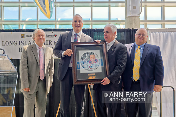 Garden City, NY, USA. June 21, 2018. L-R, JOSHUA STOFF, Curator of Cradle of Aviation Museum; astronaut MICHAEL MASSIMINO; ANDREW PARTON, Executive Director of CAM; and GREG SANTI, Human Resources Manager at Curtiss Wright, pose at 10th Annual Luncheon. (© 2018 Ann Parry/Ann-Parry.com)