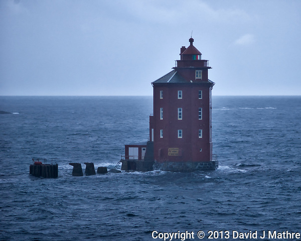 Kjeungskjær Lighthouse in Norway on a Cold Windy Rainy Winter Day from the Deck of the Hurtigruten MS Nordkapp. Image taken with a Nikon D800 and 180 mm f/2.8D lens (ISO 400, 180 mm, f/2.8, 1/320 sec).Kjeungskjær Lighthouse (David J Mathre)