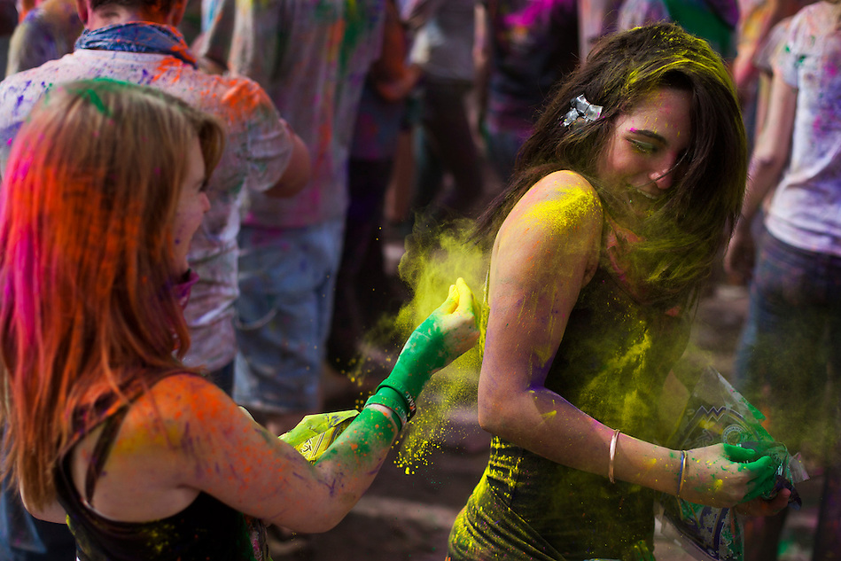 Holi Festival of Colors generates a crowd of all ages at the Lotus Temple, in Spanish Fork, Utah on Saturday, Mar. 24, 2012. Colored powder is thrown in the air and on one another for the Hindu celebration of spring making a beautiful spectacle. (Photo by Benjamin B. Morris �©2012) (Benjamin B. Morris)