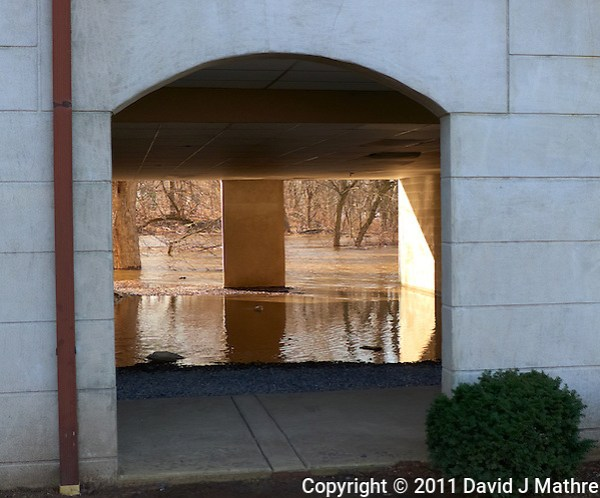 Delaware River -- Flood Stage. Looking under the Lambertville Inn. Image taken with a Leica D-Lux 5 (ISO 100, 10.7 mm, f/2.8, 1/320 sec). (David J Mathre)