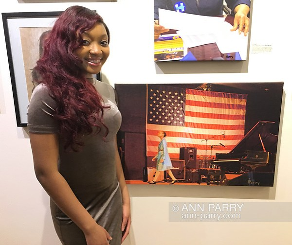 Huntington, New York, USA. March 5, 2017. Sheimyrah Mighty, 18, next to 2008 photo of herself, at Opening Reception for