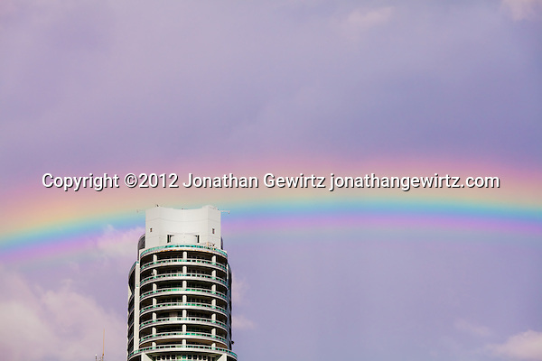 A rainbow appears in the sky behind a Miami condo building. (© 2012 Jonathan Gewirtz / jonathan@gewirtz.net)