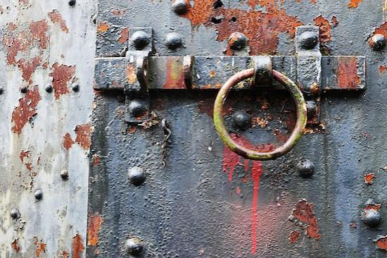 Rusty steel latch on steel bunker tunnel door, Artillery Hill, Fort Warden State Park, Port Townsend, Washington, USA (Brad Mitchell)
