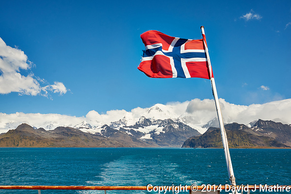 Norwegian Flag on the Aft Deck of the MS Fram as we Departed Grytviken, South Georgia. Image taken with a Fuji X-T1 camera and 23 mm f/1.4 lens (ISO 200, 23 mm, f/16, 1/125 sec). (David J Mathre)