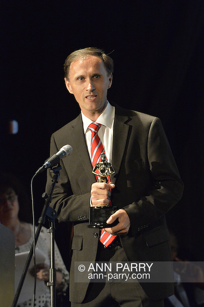 "Bellmore, New York, USA. July 21, 2016. BERNHARD RAMMERSTORFER accepts ""Alan Fortunoff Humanitarian Award"" for documentary""Taking the Stand"" which he was producer, director and writer of, at The19th Annual Long Island International Film Expo Awards Ceremony, LIIFE 2016, held at the historic Bellmore Movies. LIIFE was called one of the 25 Coolest Film Festivals in the World by MovieMaker Magazine. (Ann Parry/Ann Parry, ann-parry.com)"