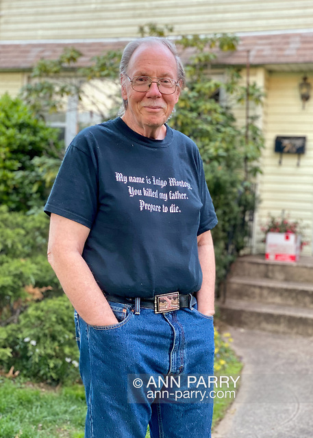 """Garden City Park, New York, U.S. May 2, 2020. Behind Bob Stuhmer, social distancing in his front yard, is box of food, on Long Island. (© 2020 Ann Parry/Ann-Parry.com)"