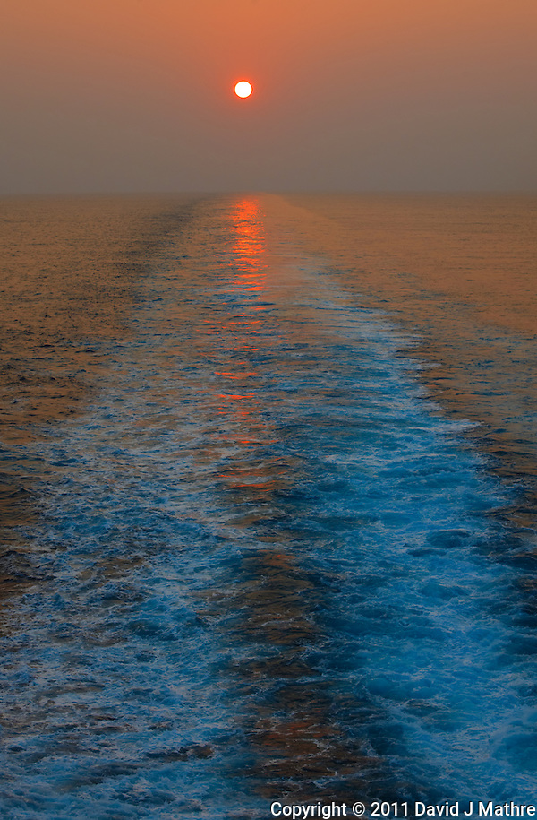 Sunset looking aft on the M/V Explorer. Image taken with a Nikon D3x and 70-300 mm VR lens (ISO 100, 75 mm, f/9, 1/200 sec). Raw image processed with Capture One Pro 6, NIK Color Efex Pro Contrast, NIK Define 2, and converted to JPG/sRGB with Photoshop CS5. (David J Mathre)