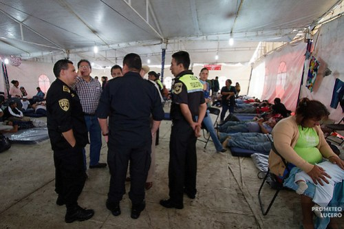 "State police officers and local authorities stand inside the migrants temporary shelter in Tultitlán before asking migrants to leave the place, on on August 3rd, 2012. Tultitlán local authorithies ordered to dismantle the temporary shelter that was placed under a bridge in Tultitlán after shelter ""San Juan Diego Cuauhtlatoatzin"" in Lecheria, was closed on July 9th, 2012. (Photo: Prometeo Lucero) (Prometeo Lucero)"