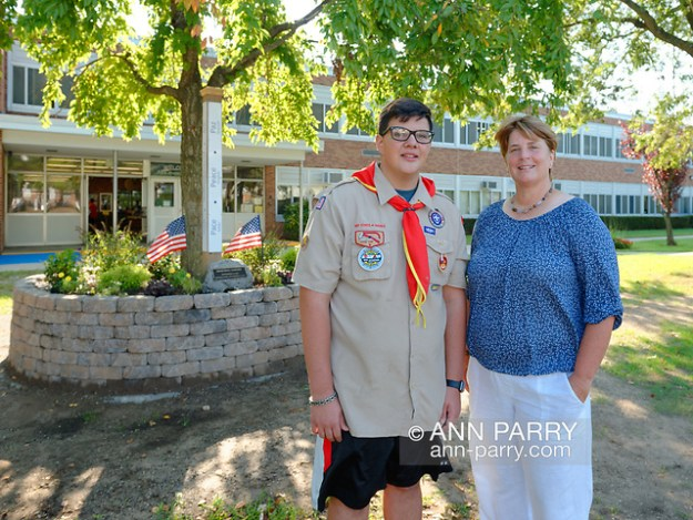 North Merrick, New York, U.S. September 11, 2019. L-R, NICHOLAS CARRANO, 15, of Merrick, a member of Boy Scout Troop 123, and Park Avenue School Principal EILEEN SPEIDEL pose for photo after outdoor remembrance ceremony on 18th Anniversary of terrorist attacks on September 11, 2001. (© 2019 Ann Parry/Ann-Parry.com)