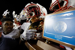 The PIAA AAA State Championship trophy is kissed by the players. (Bastiaan Slabbers/for NewsWorks) (Bastiaan Slabbers)