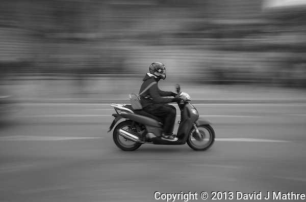 Motorcycle Passing the Sagrada Familia Cathedral in Barcelona, Spain. Image taken with a Leica X2 camera (ISO 100, 24 mm, f/16, 1/15 sec). In camera B&W. (David J Mathre)