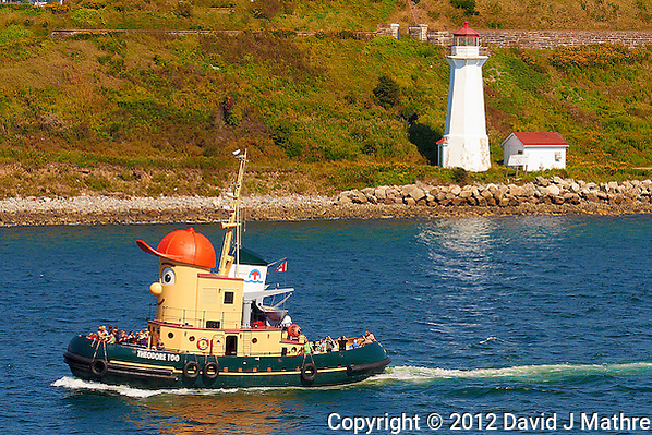 Theodore Too and Lighthouse in the Halifax Harbor. The Theodore Too is an old tugboat that has been converted into a harbor tour boat. It looks like a cartoon character. We saw it go past the ship several times during the day. Image taken with a Nikon 1 V1 camera and 30-110 mm VR lens (ISO 100, 42.2 mm, f/5.6, 1/400 sec). (David J Mathre)