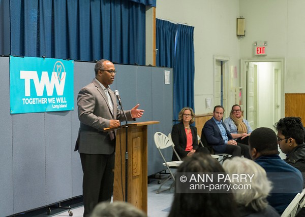 Wyandanch, New York, USA. March 26, 2017. At podium, DuWAYNE GREGORY, Presiding Officer and Suffolk County Legislator (Democrat - District 15), is speaking at Politics 101 event, the first of series of activist training workshops for members of TWW LI, the Long Island affiliate of national Together We Will. Speakers seated right of him are, L-R, LAURA CURRAN, JAY JACOBS, and LAUREN CORCORAN-DOOLIN. (Ann Parry/Ann Parry, FromLongIsland.com)