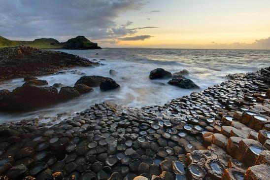 Waves splashing over basalt columns near sunset, Giant's Causeway, County Antrim, Northern Ireland, United Kingdom