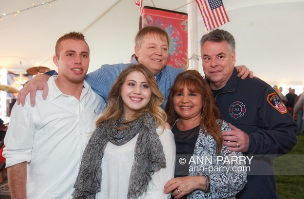East Meadow, New York, U.S. March 31, 2012. Back row L-R, Firefighter RAY PFEIFER and Congressman PETE KING (Rep. - NY02), and, front row, son TERRENCE PFEIFER, daughter TAYLOR PFEIFER, and wife CARYN PFEIFER, pose for photo at fundraiser for Ray Pfeifer, an FDNY firefighter battling cancer after months of recovery efforts at Ground Zero following 9/11 2001 Twin Towers attack. Benefit was held at East Meadow Firefighters Benevolent Hall. (Ann Parry/Ann Parry, ann-parry.com)