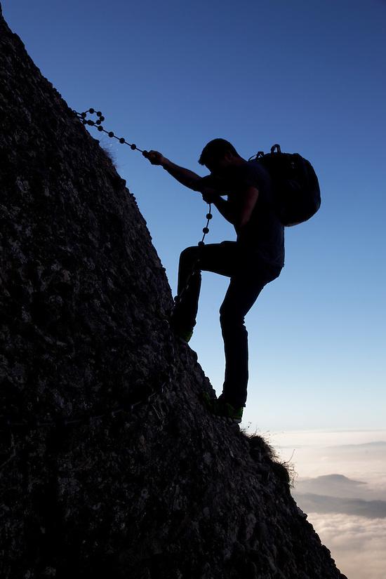 Man rappelling on the Arschbagge near summit of Mount Rigi, Bänderenweg route, Switzerland, Europe (Brad Mitchell)