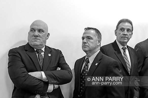 Mineola, NY, USA. March 5, 2012. L-R, Nassau PBA President JAMES CARVER, PBA's Sergeant-at-arms JAMES McDERMOTT, and President of Superior Officers (SOA) GARY LEARNED attend Nassau County Legislature meeting when legislators vote to confirm Thomas Dale as Police Commissioner and to consolidate 8 police precincts into four.  (© 2012 Ann Parry/Ann-Parry.com)