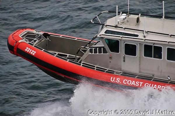 US Coast Guard Escort for the Alaska Marine Highway M/V Columbia leaving Bellingham Washington for Alaska. Image taken with a Nikon D300 and 18-200 VR lens (ISO 200, 200 mm, f/7, 1/160 sec). (David J. Mathre)