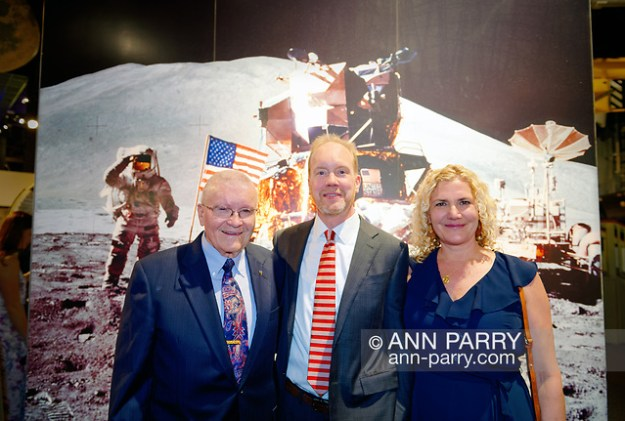 Garden City, New York, U.S. June 6, 2019. L-R, Apollo 13 astronaut FRED HAISE, PETER KELLY and KELLY KELLY, pose in front of moon landing mural at Cradle of Aviation Museum during Apollo at 50 Anniversary Dinner, an Apollo astronaut tribute celebrating the Apollo 11 mission Moon landing. Pete Kelly is youngest of 5 sons of Thomas J. Kelly, who led the design team for the Lunar Module, and is commonly called the Father of the Lunar Module. (Ann Parry/Ann Parry, ann-parry.com)