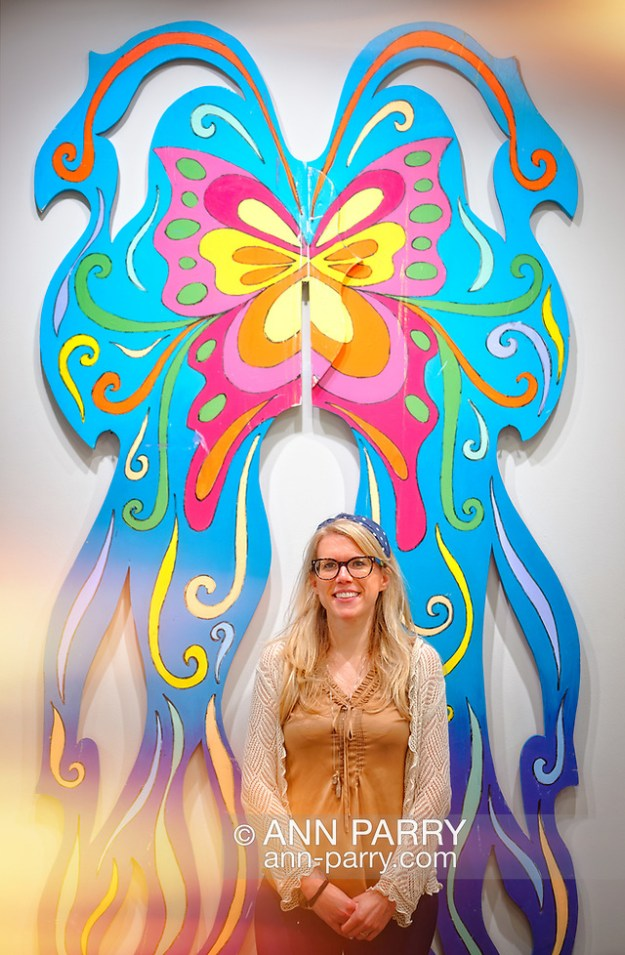 Roslyn, New York, U.S. September 13, 2019. LAURIE GRAB poses in front of large butterfly Animodules at ANIMODULES Agents of Peace exhibit Farewell Reception and Founders' talk by GARY BARAT and CHANDRI BARAT, at the Nassau County Museum of Art's Manes Art & Education Center, named for Dr. HARVEY MANES, who was in attendance and spearheaded the exhibit. (© 2019 Ann Parry/Ann-Parry.com)
