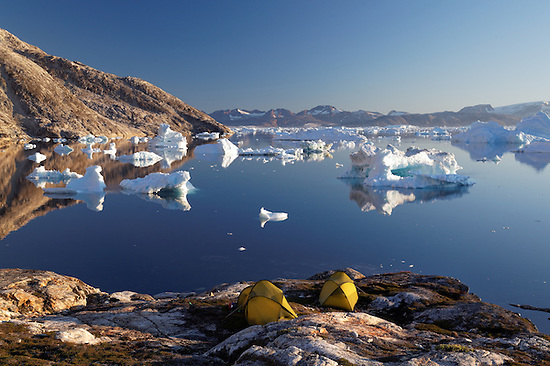 Icebergs and sea kayaker's camp on edge of Sermilik Fjord near settlement of Tiniteqilaq, East Greenland (Brad Mitchell)