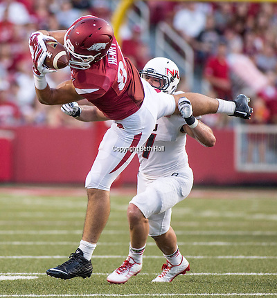 Sep 20, 2014; Fayetteville, AR, USA; Arkansas Razorbacks tight end Hunter Henry (84) pulls down a pass as Northern Illinois University Huskies linebacker Michael Santacaterina (7) looks on during the first half of a game at Donald W. Reynolds Razorback Stadium. Mandatory Credit: Beth Hall-USA TODAY Sports (Beth Hall/Beth Hall-USA TODAY Sports)