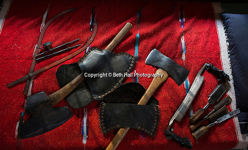 Antique hand tools used for log work lay on a bed at the home of Robert Runyon in Sugar Tree Hollow in Winslow, Arkansas, for Out Here Magazine. Photo by Beth Hall (Beth Hall)