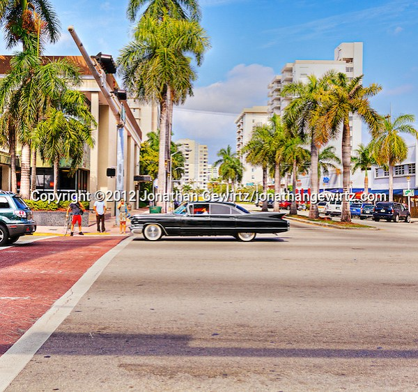 A black Cadillac Sedan de Ville from around 1960 on Collins Avenue in Miami Beach, Florida. (©2012 Jonathan Gewirtz)