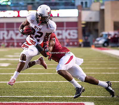 Sep 20, 2014; Fayetteville, AR, USA; Northern Illinois University Huskies wide receiver Aregeros Turner (22) gets past Arkansas Razorbacks cornerback D.J. Dean (2) to score a touchdown during the first half of a game at Donald W. Reynolds Razorback Stadium. Mandatory Credit: Beth Hall-USA TODAY Sports (Beth Hall/Beth Hall-USA TODAY Sports)