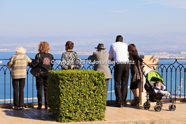 Sabbath sightseers on a scenic overlook on Haifa's Mount Carmel take in the view of the Bahai temple and gardens, city, port and harbor below. (2012 Jonathan Gewirtz / jonathan@gewirtz.net)