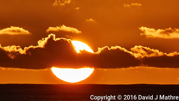 Sunrise from the deck of the MV World Odyssey while traveling across the Pacific Ocean. Image taken with a Nikon 1 V3 camera and 70-300 mm VR lens (ISO 200, 300 mm, f/11, 1/1000 sec). (David J Mathre)