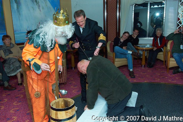 King Neptune and the Ship Captain Performing a Baptism at the Crossing the Arctic Circle Ceremony. Image taken with a Nikon D2xs and 12-24 mm f/4 lens (ISO 200, 24 mm, f/6.3, 1/200 sec). (David J Mathre)