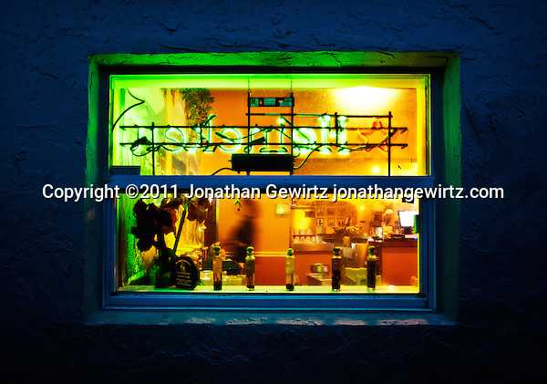 A colorful view into a restaurant at night. (Jonathan Gewirtz)
