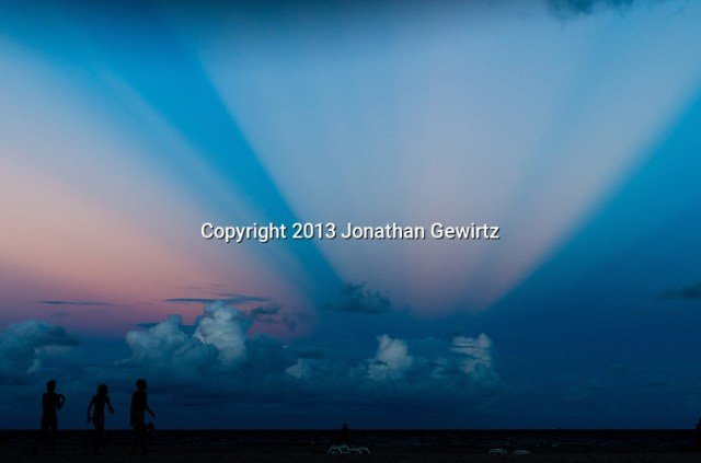 Anti-crepuscular rays of the setting sun are visible over the Atlantic Ocean off Hollywood Beach, Florida. (Jonathan.Gewirtz@gmail.com)