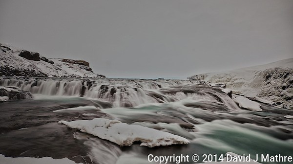 Gullfoss (Golden Waterfall) on a Late Winter Afternoon. One of most popular tourist attractions in Iceland. Long Exposure taken with a Fuji X-T1 camera and Zeiss 12 mm f/2.8 lens (ISO 200, 12 mm, f/16, 9 sec) with a hand-held 10 stop Singh-Ray neutral density filter. (David J Mathre)