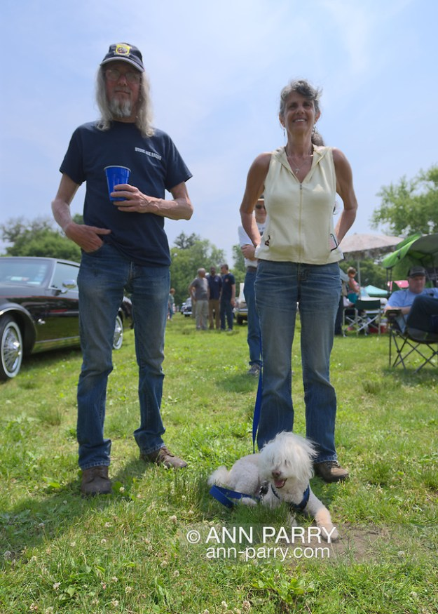 Old Westbury, New York, USA. June 2, 2019. L-R, RUSTY BECKER and DEBBIE DUGAN, both of Glen Head, and SAMMY, a 14-year-old Bichon Poo, a Bichon Poodle cross (Bichapoo), are at the 53rd Annual Spring Meet Antique Car Show. Dugan entered her 1951 Chevy pickup truck in the show. Event was sponsored by the Greater NY Region (NYGR) of the Antique Automobile Club of Americaa (AACA), at Old Westbury Gardens, a Long Island Gold Coast estate. (Ann Parry/Ann Parry, ann-parry.com)