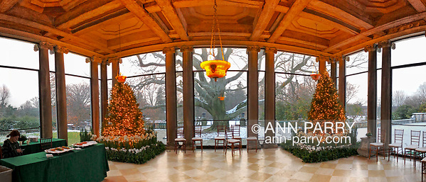 Old Westbury, New York, USA. December 17, 2017. At Westbury House, two Christmas trees flank the Porch facing West, with panoramic view of snowy grounds during Winter Holiday event at Old Westbury Gardens. (© 2017, Ann Parry/Ann-Parry.com)