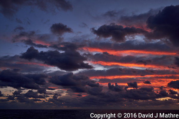 Colorful Dawn clouds over the Pacific Ocean from the deck of the MV World Odyssey. Image 1 of 6 taken with a Fuji X-T1 camera and 23 mm f/1.4 lens (ISO 200, 23 mm, f/5.6, 1/60 sec). Raw images processed with Capture One Pro. (David J Mathre)