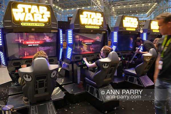 Manhattan, New York City, New York, USA. October 10, 2015. Visitors are playing STAR WARS Battle Pod, an aerial combat game set in the Star Wars universe, at the 10th Annual New York Comic Con. NYCC 2015 is expected to be the biggest one ever, with over 160,000 attending during the 4 day ReedPOP event, from October 8 through Oct 11, at Javits Center in Manhattan (Ann Parry/Ann Parry, ann-parry.com)