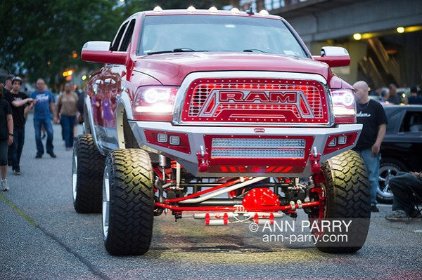 Bellmore, New York, USA. August 11, 2017. Red RAM lifted underlit truck drives past onlookers at the Bellmore Friday Night Car Show (Ann Parry/Ann Parry, ann-parry.com)