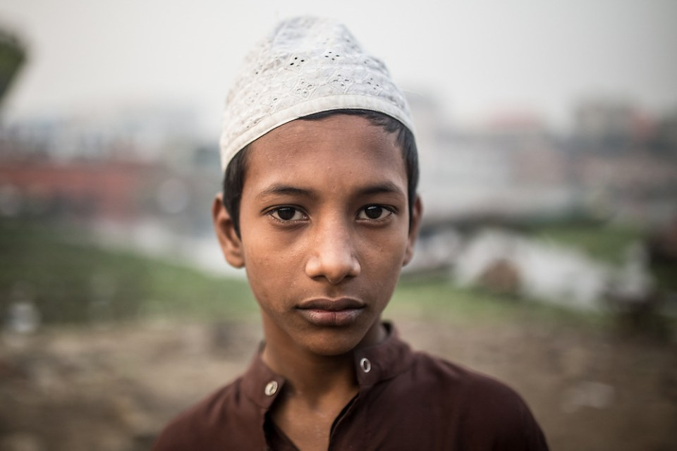 A boy photographed in the Dhaka boat yards, across the river from Sadarghat Boat Terminal. (Paul Ratje)