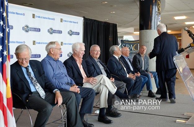 Garden City, New York, U.S. June 6, 2019. After speaking at lectern on stage, at extreme right, ANDY PARTON, President of Cradle of Aviation Museum, turns to guests sitting behind him, L-R, Apollo 16 Lunar Pilot CHARLIE DUKE, Apollo Flight Director MILT WINDLER, Apollo 9 Lunar Pilot RUSTY SCHWEICKART, Apollo 13 Lunar Pilot FRED HAISE, Apollo 17 Lunar Pilot HARRISON SCHMITT, Apollo Flight Director GERRY GRIFFIN, and Apollo 7 Lunar Pilot WALT CUNNINGHAM, during Cradle of Aviation Museum's Apollo Astronauts Press Conference during its day of events celebrating 50th Anniversary of Apollo 11. (Ann Parry/Ann Parry, ann-parry.com)