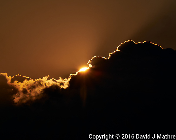 Sun peaking out from behind the clouds. From the deck of the MV World Odyssey docked in Yokohama, Japan. Image taken with a Fuji X-T1 camera and 55-200 mm OIS lens (ISO 200, 200 mm, f/22, 1/1000 sec). (David J Mathre)