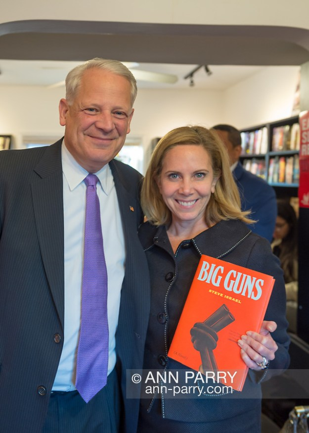 Rockville Centre, NY, USA. April 201, 2018. L-R, Rep. STEVE ISRAEL and Hempstead Town Supervisor LAURA GILLEN pose for photo at special event for Nassau County debut of the former Congressman's (NY - Dem) newest novel BIG GUNS - a satire of the strong gun lobby, weak Congress, and a small Long Island town. Event was held at Turn of the Corkscrew Books & Wine store. (© 2018 Ann Parry/Ann-Parry.com)