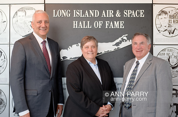 Garden City, NY, USA. June 21, 2018. L-R, Astronaut Mike Massimino, Deborah Henley, and Louis Mancuso Jr. pose at Long Island Air & Space Hall of Fame at Cradle of Aviation Museum. (© 2018 Ann Parry/Ann-Parry.com)