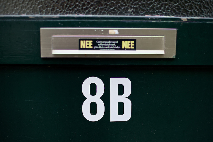 8B, the house number marked on the front door of my old home. The sticker on the letter slot indicates the residents prefer no spam. After living abroad for more than three years I visited my old home town. Wondering what has changed I packed both my curiosity and a camera. (Original posted as part of a photo essay 'Revisiting Familiar Grounds' here: http://www.basslabbers.com/WP/?p=1320) (Bas Slabbers /Photography)
