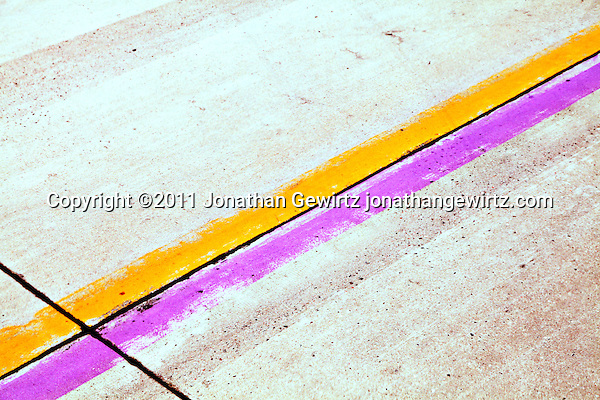 Yellow and purple lane markers on an airport runway. (Jonathan Gewirtz)