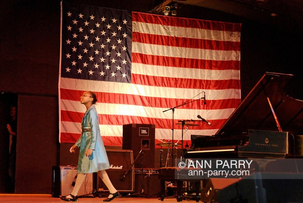 """East Meadow, New York, U.S. October 15, 2008. SHEIMYRAH MIGHTY, a 10-year-old Haitian American singer, walks across stage of Harry Chapin Theater after singing God Bless America at start of Obama Rally at Eisenhower Park. (© 2008 Ann Parry/AnnParry.com)"