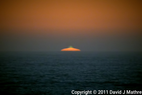 Green Flash at Sunset over the Pacific Ocean off Mexico. Image taken with a Leica V-Lux 20 camera (ISO 80, 49.2 mm, f/6.3, 1/200 sec). (David J Mathre)